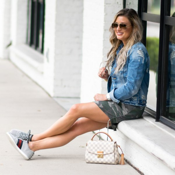 Denim jacket with camo mini shorts and light gray chambray sneakers