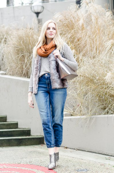 Denim jacket with a green scarf and short blue jeans