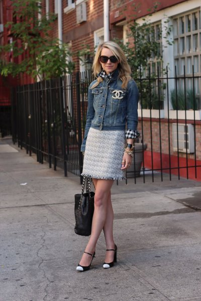Denim jacket with mini skirt and white and black toe shoes