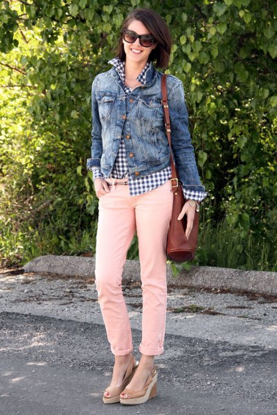 Denim jacket with checked shirt and cream-colored slim fit jeans