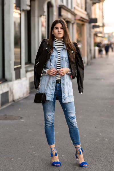 Denim jacket with ripped jeans and royal blue strappy sandals