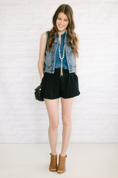 Denim vest with black, flowing denim shorts and open toe boots