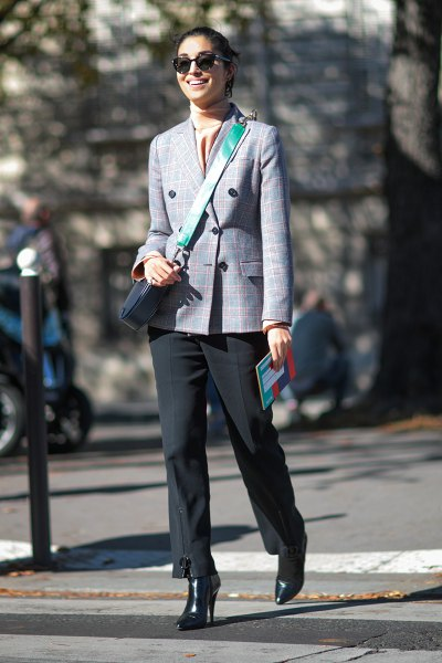 Double-breasted checked blazer with a light pink silk top and black trousers