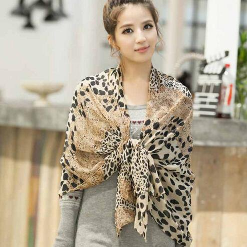 drape cheetah chiffon scarf over the shoulder