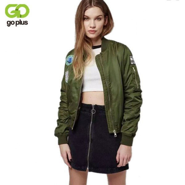 embroidered olive green bomber jacket with white crop top and black skyscraper