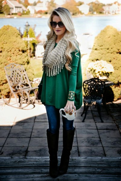 Emerald green peplum long-sleeved top with infinity scarf with fringes