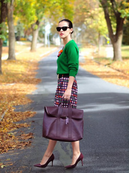 emerald green sweater with checked pencil skirt