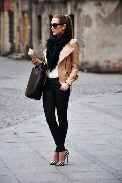 black faux fur scarf with brown leather jacket and striped heels