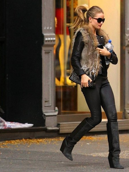 brown vest made of faux fur with black leather jacket and knee-high wedge boots