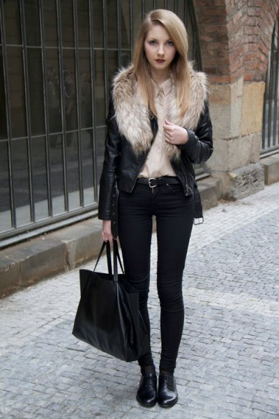 Biker jacket with a faux fur collar and black skinny jeans