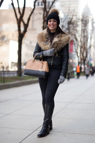 Leather jacket with a faux fur collar and knee-high boots