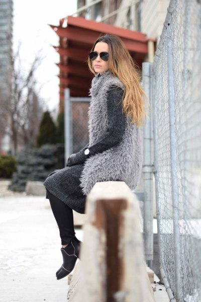 gray vest made of faux fur over the matching knee-length wool dress