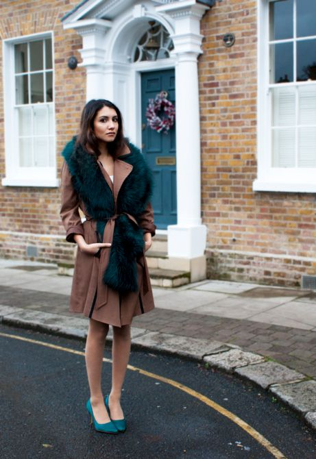 Trench coat with a faux fur scarf