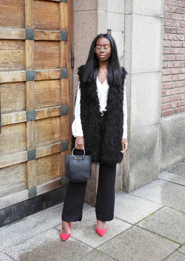 Long black faux fur vest