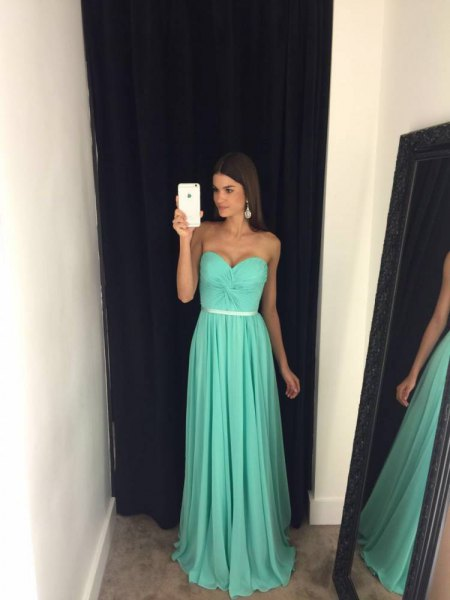 Fit and flare belt strapless floor length pleated ball gown