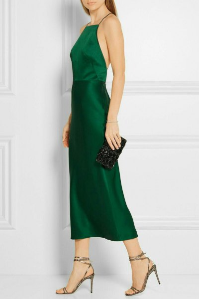Fit and flare halter green silk dress with clutch purse