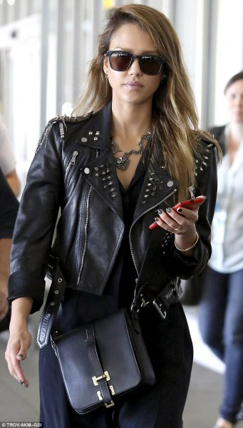 fitted and short leather jacket with black knee-length shirt dress