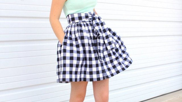 fitted halterneck top with black and white checked minirater skirt