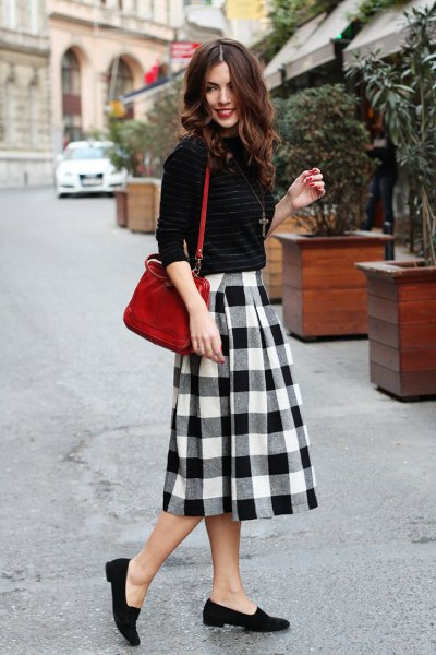 flared black midi plaid skirt black sweater