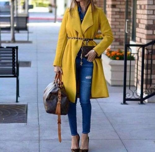 Long-liner yellow coat with fleece belt and skinny jeans with blue ankles