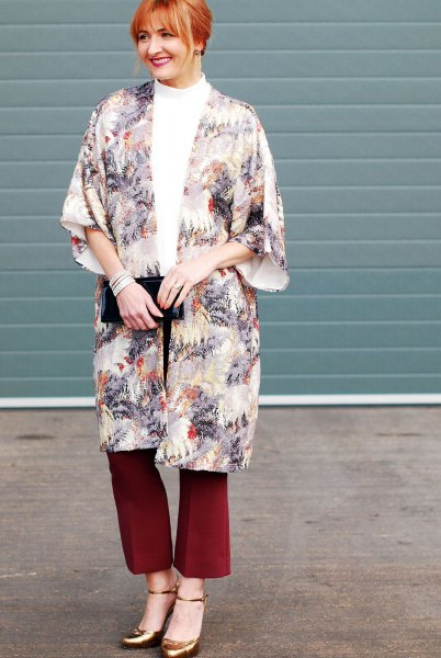 Flora printed long cape with red flared trousers and bronze heels