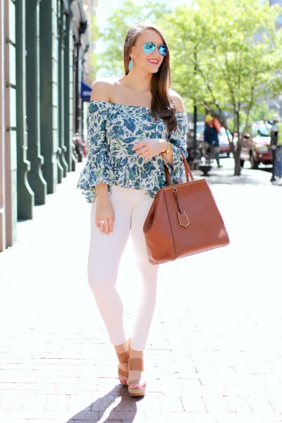 floral bell sleeves above white skinny jeans