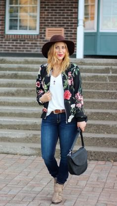 floral bomber jacket with white vest and black felt hat
