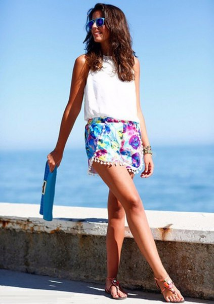 Mini shorts with floral fringes, white sleeveless halterneck top