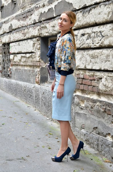 Flower jacket with a sky blue pencil skirt and black heels
