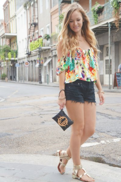 Flowery off-the-shoulder blouse black mini-shorts