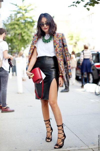Blazer with floral print and black faux leather skirt with side slit