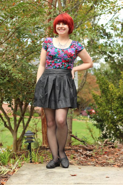 matching pink t-shirt with floral pattern and pleated mini skirt