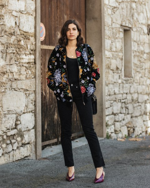 Velvet bomber jacket with a floral pattern and black ankle jeans