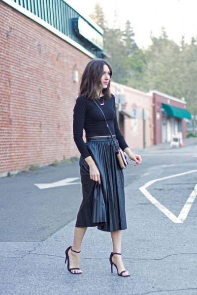 Figure-hugging, shortened knitted sweater with black pleated midi skirt