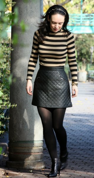 Figure-hugging green and black striped sweater