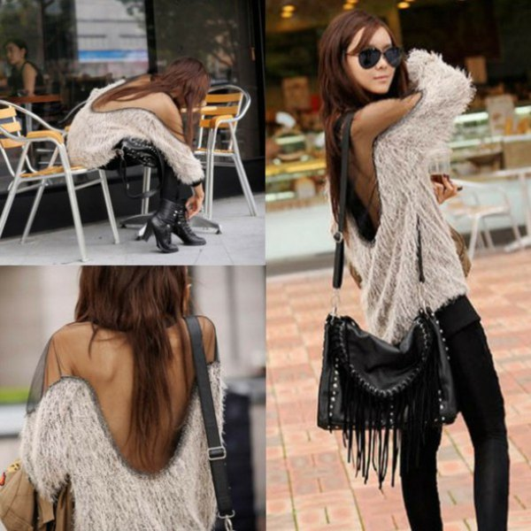Fuzzy two-tone sweater with an open back and black skinny jeans