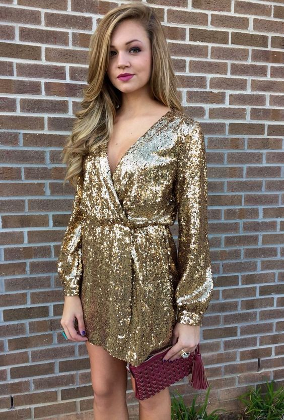 wrapped in golden sparkling dress