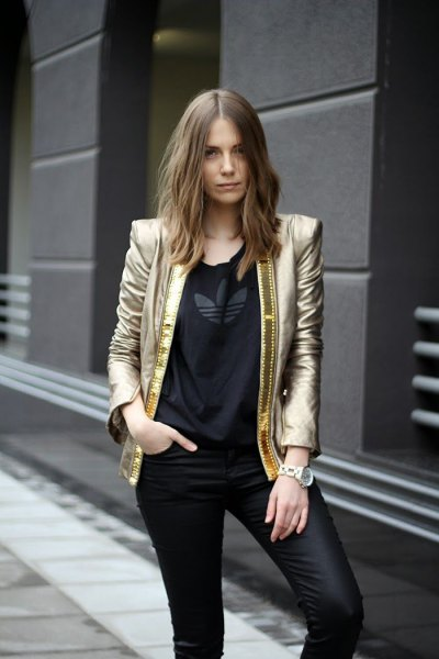 golden blazer with black t-shirt and leather gaiters