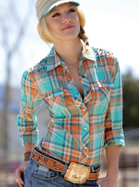 golden cowboy belt with orange and pink plaid shirt