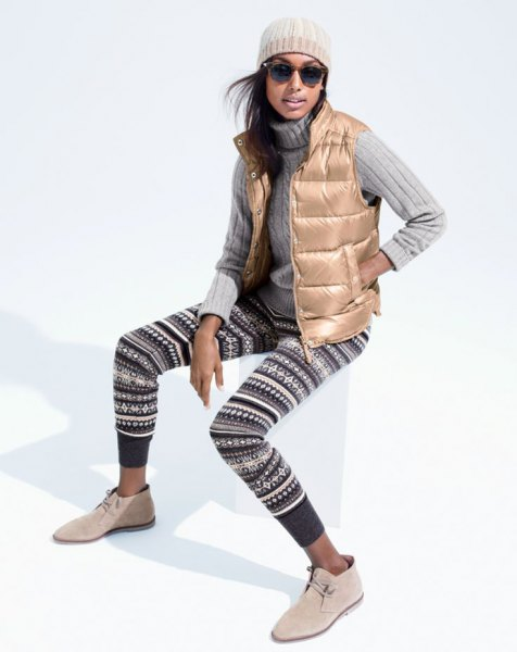 golden down vest with black and white tribal sweater leggings