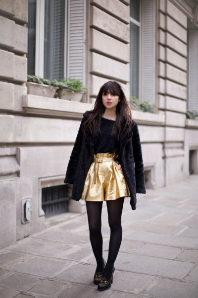 golden flowing shorts with a black teddy coat