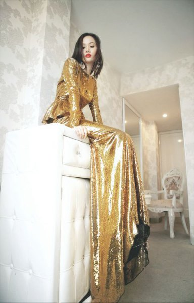 Gold long sleeved floor length flowing dress