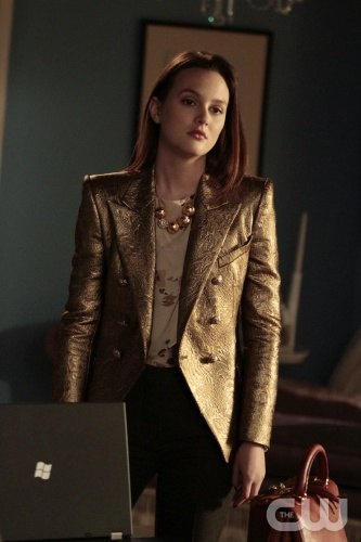 golden metallic blazer with white floral blouse and black jeans