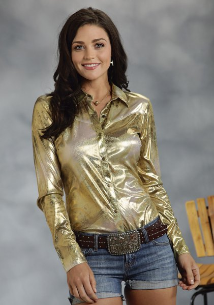 gold metallic shirt with black belt and denim shorts with cuffs