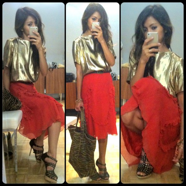 gold metallic short-sleeved T-shirt with red midi skirt