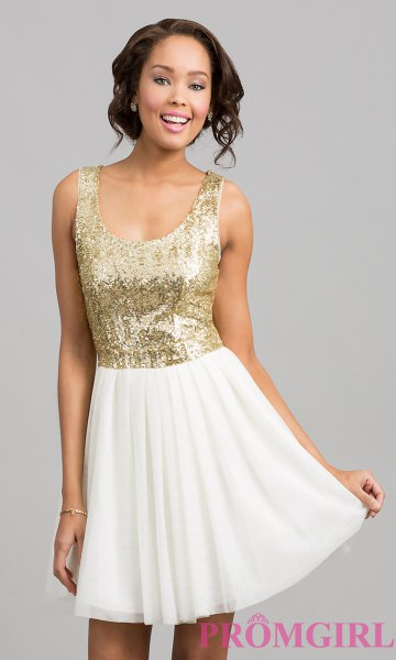 golden sequin top with scoop neckline and white minirater skirt