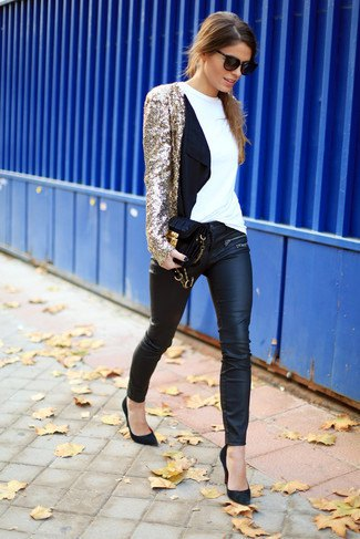 golden sequin jacket with black leather gaiters