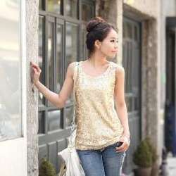 gold sequin tank top with white leather handbag