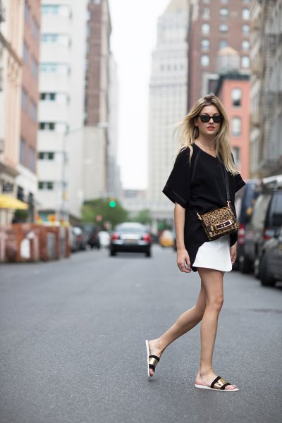 Gold sandals with black t-shirt and white skirt