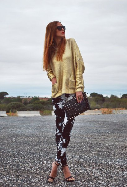 golden sweater with black and white leggings and open toe heels